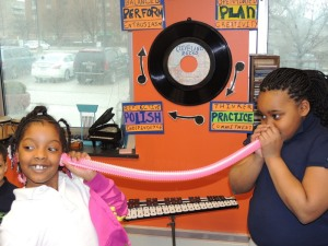 Jolani and Amiyah 'squish' their sound waves in a tube.
